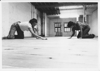 Lisa Doolittle and Norma Wood sanding the floor of the Co-Motion studio, 1977